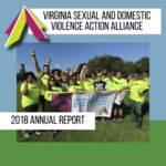 Cover of 2018 Annual Report has a group staff photo of about two dozen people in the same neon yellow shirts standing behind a banner on grass.