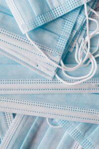 Photo of a pile of disposable blue medical face masks by Karolina Grabowska from Pexels