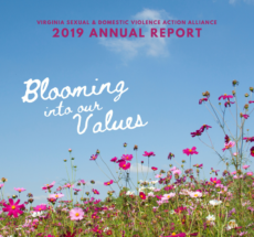 """Cover of the 2019 Annual Report features a blue sky and field of pink, purple, and white wildflowers, with the title """"Blooming into our values"""" in white text."""