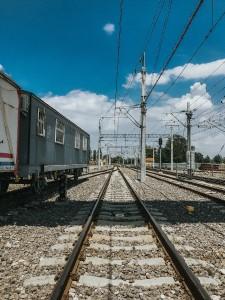 Train next to train tracks.