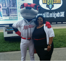 Photo of Quan Williams of the Action Alliance with the Richmond Flying Squirrels mascot.