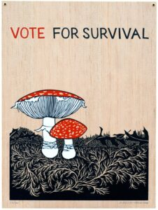 "An image of two mushrooms with red tops, one larger and one smaller, next to each other on top of a black grassy ground with a light wood grain background. At the top are the words, ""vote for survival."""
