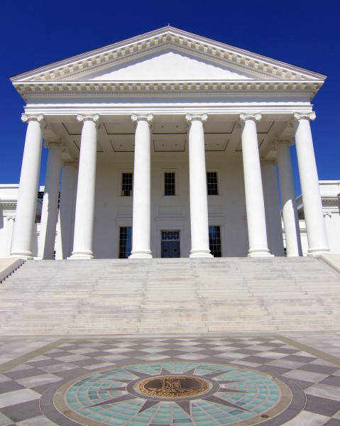Head-on Image of the front of Virginia State Capitol with blue sky.